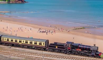 Steam train going past at Goodrington Sands in Paignton, Devon
