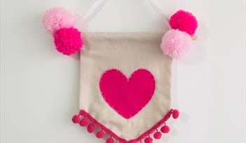 Create a Pom Pom Heart Wallhanging